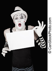 mime in striped gloves and hat, holding a white blank - Ape...