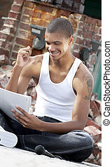 Young artist at work - Young African American adult male...