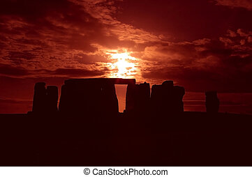 An image of Stonehenge taken at sunset, producing a silhouette.