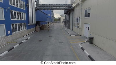 Process area of food plant with road. Aerial view....
