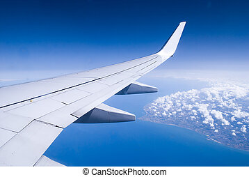 Aeroplane wing against European Mainland.