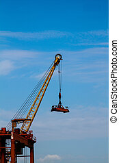 Seaport crane and containers with blue sky