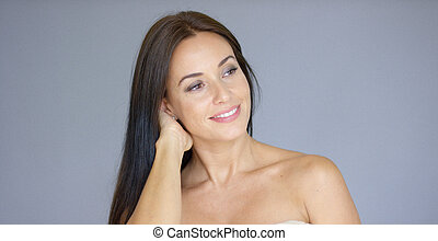 Single gorgeous woman with hand behind neck - Single...