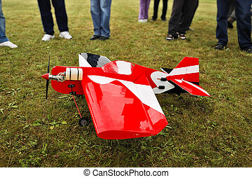 Aircraft model landed - Red and white radio controlled...