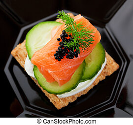 Caviar and Salmon Canape - Beluga Caviar on fresh, raw...