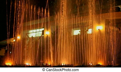 Night dancing fountain - A beautiful fountain with a night...