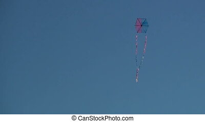 Kite flying in clear blue sky