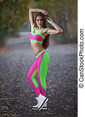 young beautiful girl in sportswear fashionable clothes outdoors
