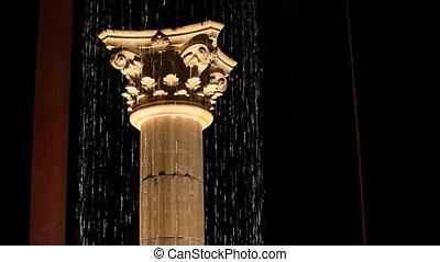 Greek column under a waterfall