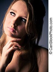 Thoughtful woman concept portrait