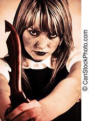 Woman maniac with knife