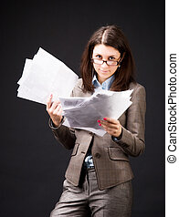 Businesswoman with sheets of paper