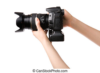 Woman hands holding professional photo camera