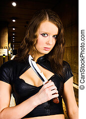 Woman maniac with knife. Underground parking.