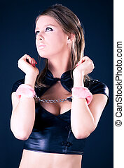 Young woman with pink handcuffs