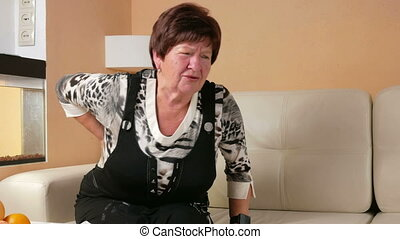 Woman aged can not get up off the couch because of back...