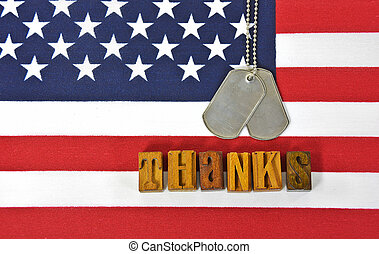 thanks to veterans with dog tags - word thanks in wooden...