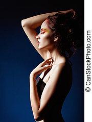 Portrait of beautiful redhead girl. Profile view - Portrait...