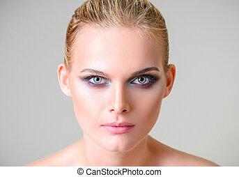Studio beauty shot: closeup portrait of beautiful young woman
