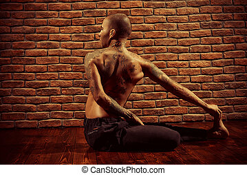 crossing pose - An experienced yoga instructor showing...