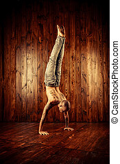 handstand pose - Yoga. Yoga master practicing yoga....