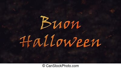 Buon Halloween text in Italian dissolving into dust to left