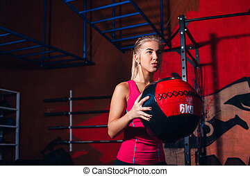 Girl with med ball - Young girl exercising with med ball in...