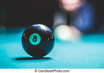 Eight pool ball and blurred human silhouette - Photograph of...