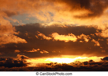 Glowing dramatic sunset clouds in sky, nature background