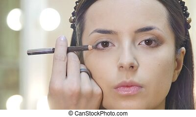 Eye makeup woman applying eyeshadow powder
