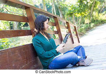 Finally ! A day off! - Young woman relaxing at the park with...