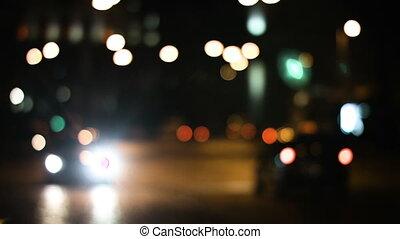 Traffic lights on the city roads. Blurred defocused light on...