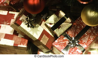 Several boxes of gifts wrapped in paper and decorated with...