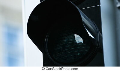 Close-up of traffic light turn green at the daytime. Picture...