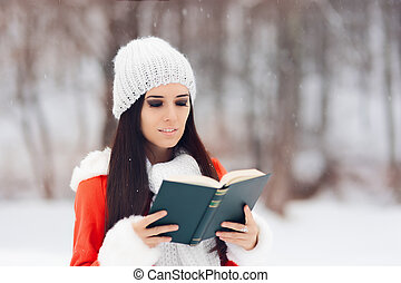 Winter Woman Reading a Book Outside in the Snow - Happy girl...