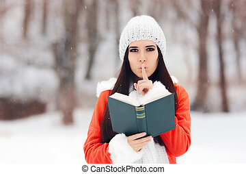Winter Woman with Finger on Her Lips Holding a Book -...