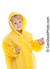 child with yellow raincoat - studio shot with child with...
