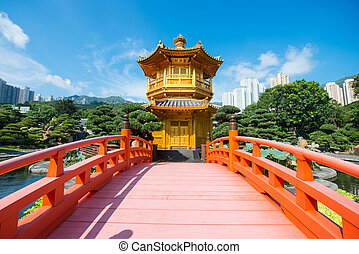 The golden pavilion and red bridge at Nan Lian garden, Hong...