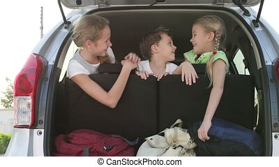 happy children sitting in car at the day time. Concept of...