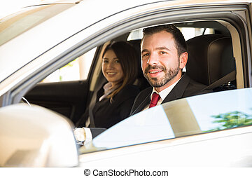 Latin coworkers driving on a business trip