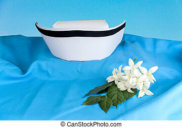 Hat nurse white and Millingtonia hortensis flowers on blue...