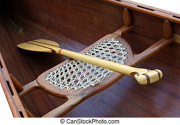 Wooden paddle inside a boat