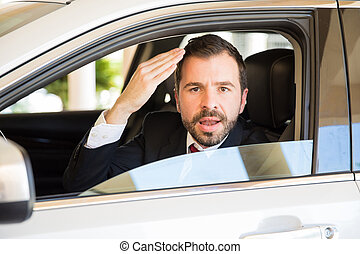 Young man suffering from road rage - Portrait of a furious...