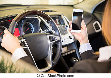 Young woman texting and driving - Point of view of a young...