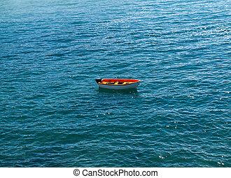 fishing boat in Caleta Negra beach in Ajuy, Fuerteventura,...