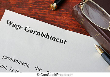 Wage Garnishment definition written on a paper.