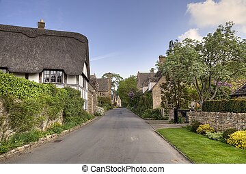 Black and white cottage, England - Thatched cottage in the...