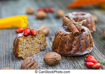 Pumpkin cake with cinnamon, rose hip and autumn leaves on...