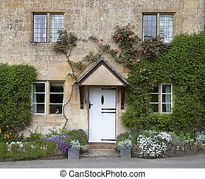 Cotswold cottage - Cottage facade with flowers, Stanton...