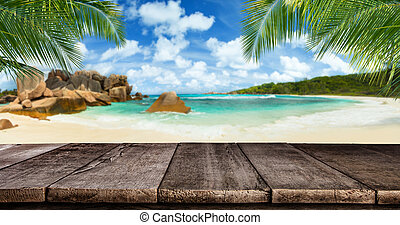 Empty wooden planks with tropical beach on background